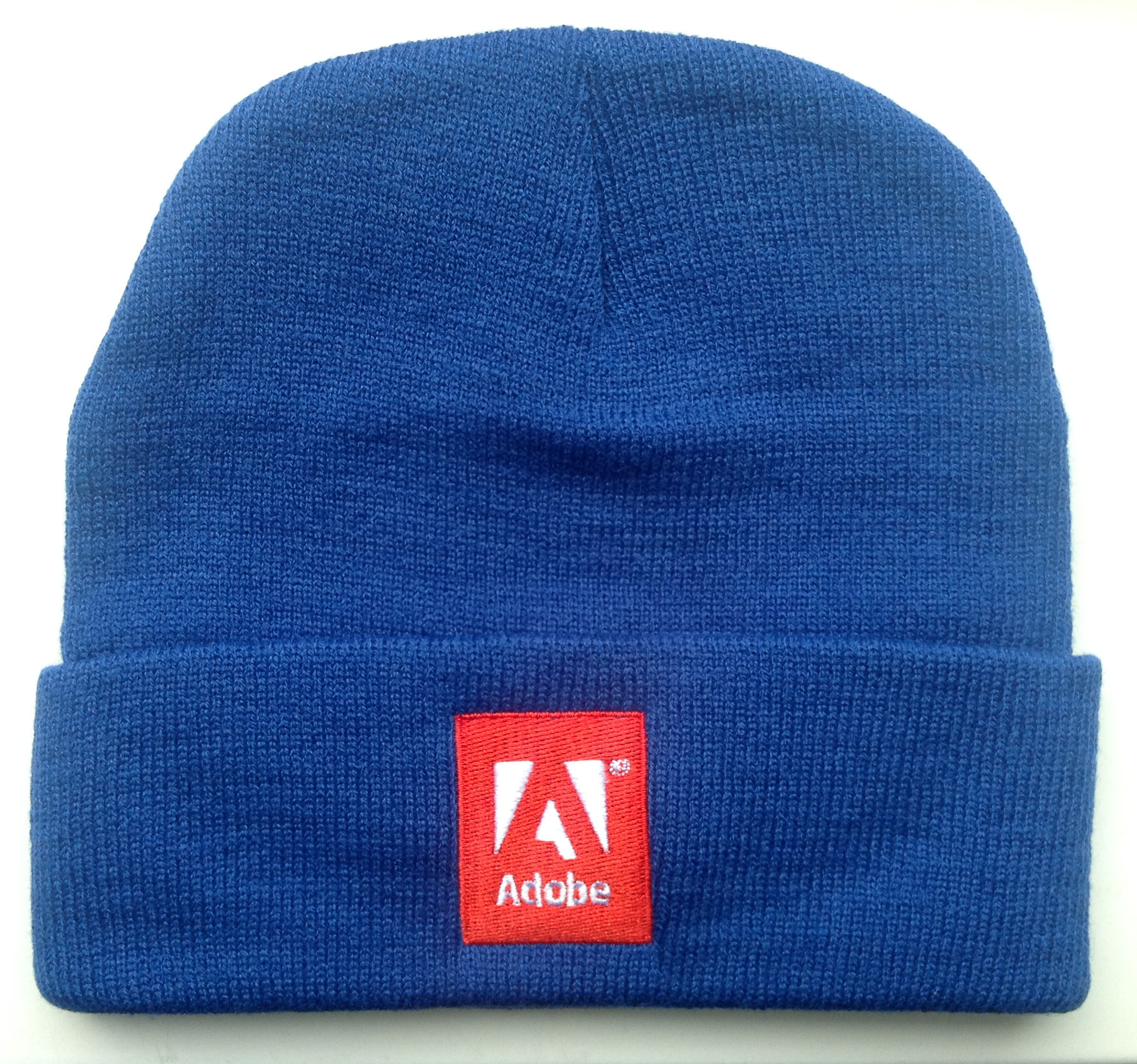 A blue beanie with Adobe logo